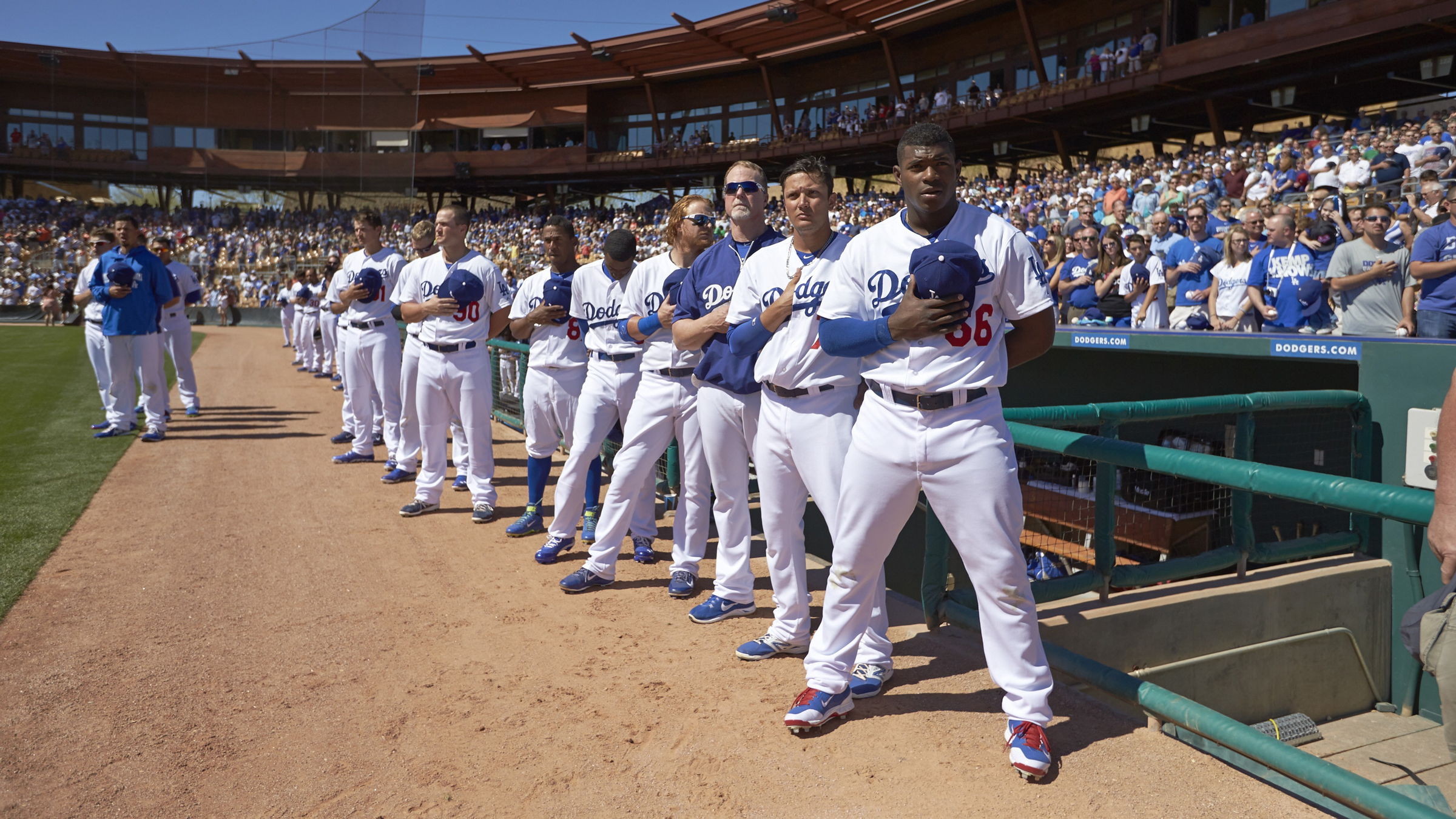 why baseball matters still los angeles dodgers yasiel puig 66 and teammates stand for the national anthem before spring training game vs san francisco giants at camelback ranch in